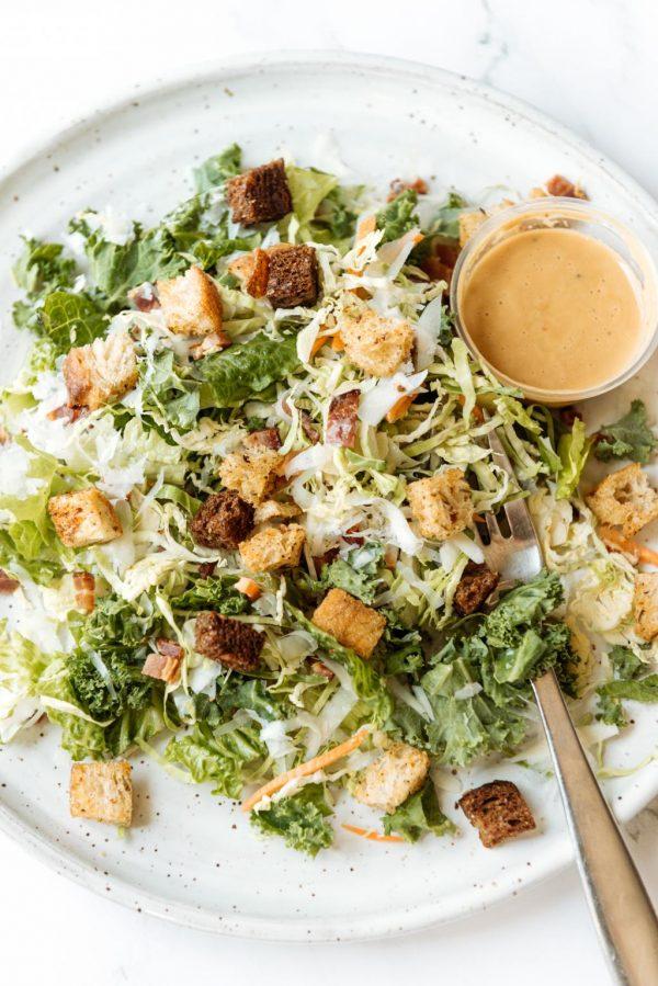 Caesar salad w/ kale, brussels, romaine, sourdough crouton + parmigiana